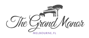 The Grand Manor Logo
